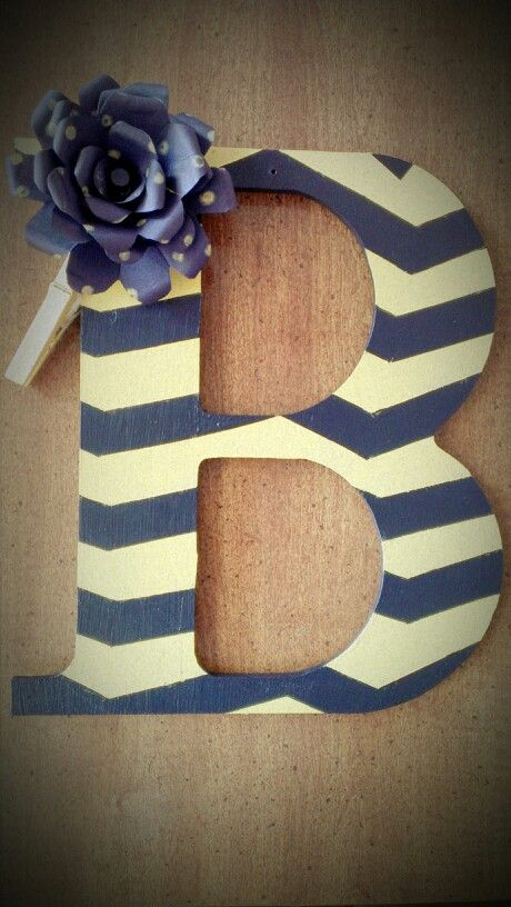 Front door letter! Hobby lobby letter, construction paper, cclothes pin, and pai...