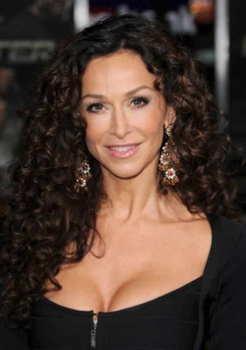 Curly hair...love Sofia Milos' natural style.