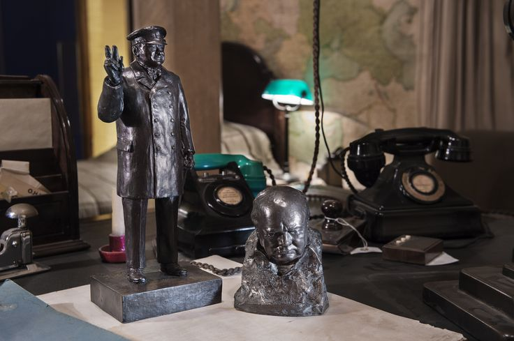 Our V for Victory Churchill figure and Bronze nemon bust, photographed on Churchill's desk in his bedroom at the Churchill War Rooms