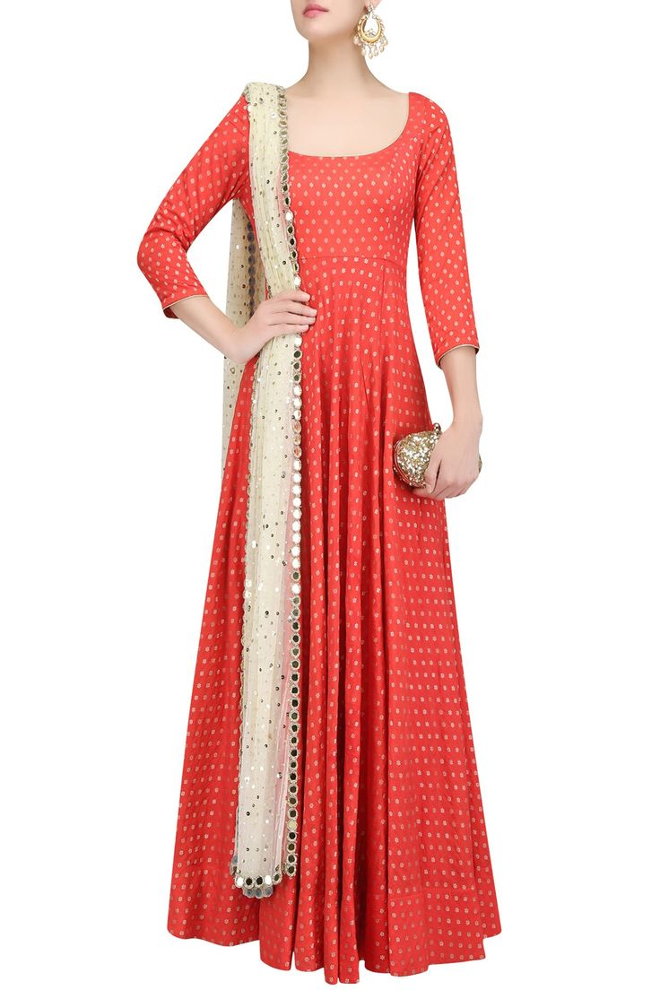Description This set features a red flared kalidaar anarkali in chanderi base paired with beige embroidered net dupatta and churidaar pants. FIT: Cut for relaxed fit. COMPOSITION: Chanderi, net. CARE: Dry clean only.