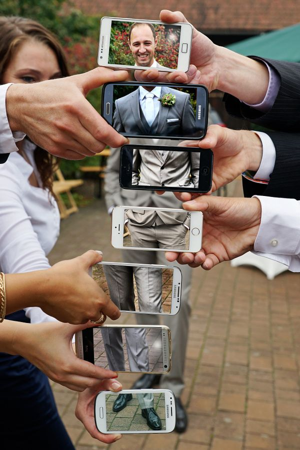 Photos of groom parts on cell phones