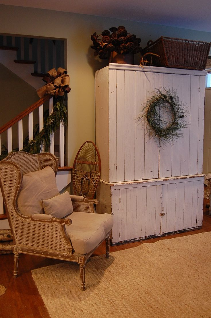 Love this cane chair with the simple linen covers next to the primitive pine closet.  Funny, looks a lot like the one I made (but I like mine better).  Lifestyle — BROADWAY+THRESHER