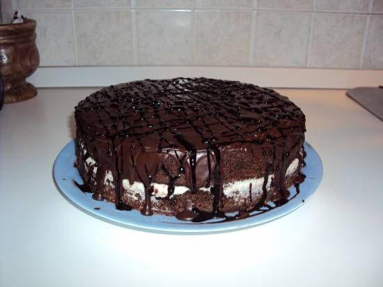 Duivelse Chocoladetaart Met Witte Chocoladevulling En Cacaog recept | Smulweb.nl