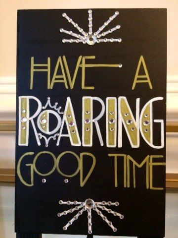 Having a Roaring Twenties themed or Great Gatsby wedding?! Want to add some glitz, glamour, and that chic extra touch to your evening party event?! Then you need to wow them everywhere!!! Which means you need these fantastic custom made Gatsby Sign! This Have a Roaring Good Time sandwich board sign was designed with your occasion in mind. Spice up your wedding or party table décor using this fun Art Deco font inspired sign. This 4x6 self-standing sign has been painted all black and features…