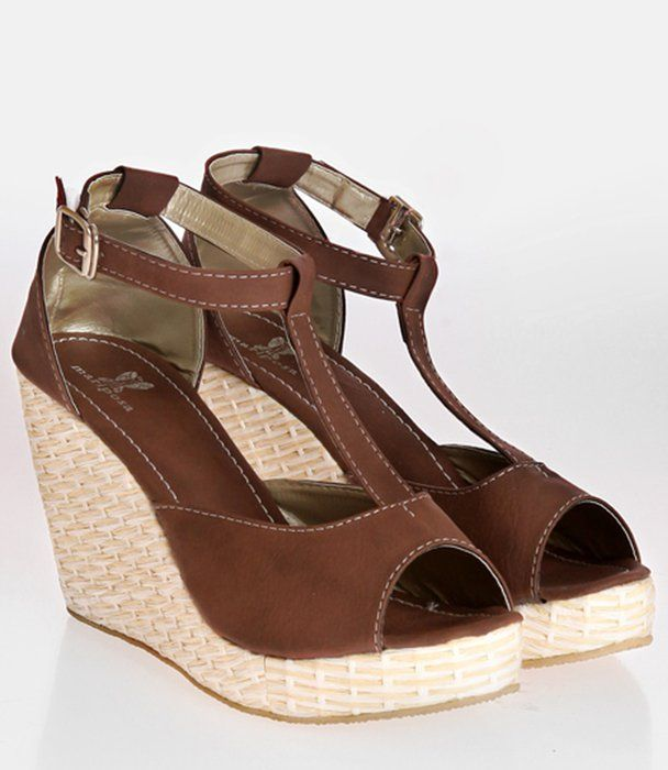Mazarine wedges in brown by Mariposa. Slip on these classic strap wedges with an ankle strap. It is detailed with contrasting stitching, straw heels and a rubber sole. Pair these with your favorite jeans and a white tank top and conquer the world. http://www.zocko.com/z/JHxBj