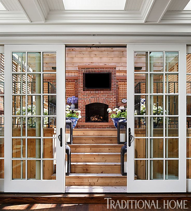 Bill and Giuliana Rancic's Chicago Brownstone - covered deck off the kitchen.