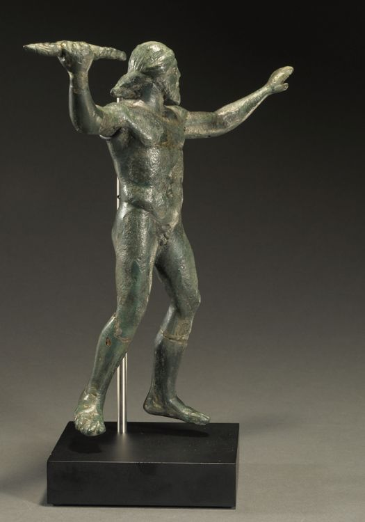 Slanted; Zeus hurling a thunderbolt.  2 of 3  Circa. Late 5th to 4th Century B.C. Materials; Bronze and metal alloys. Measurement; h. 18.50 cm. Information; Zeus is advancing and about to throw the thunderbolt along the sight line defined by his extended left arm. His hair is tied in a chignon at the nape. This statue was part of a German collection and has undergone preservation. Published; J. Eisenberg, Art of the Ancient World, 2009, no. 39. Reference; GMN01 COPYRIGHT © Royal Athena
