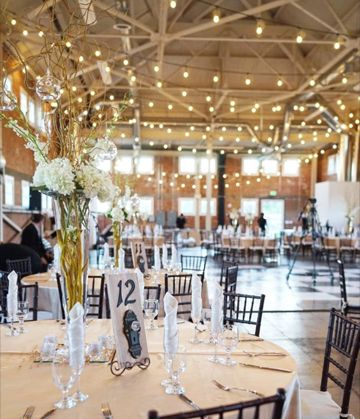 This beautiful wedding featured Ranch rentals, catering, and Ranch florist created centerpieces