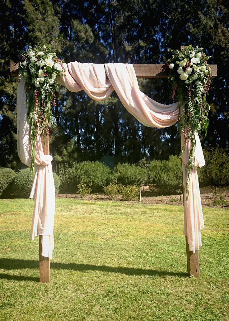 A Beautiful Arbour arrangement with floral details, a focal point for the couple
