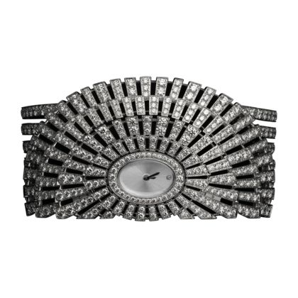 Cartier invests a wealth of ingenuity and expertise into outstanding examples of high jewelry watchmaking. A single creation can be worn in multiple ways, a tiara, pendant or brooch.A wristwatch which can also be worn as a brooch or tiara. Pure lines reveal the sparkle of a rose-cut cushion-shaped diamond.