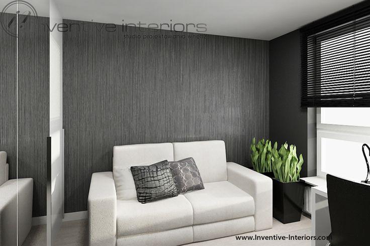 Projekt gabinetu Inventive Interiors - sofa z funkcją spania w szarym gabinecie