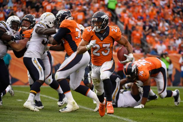 Chargers vs. Broncos:  October 30, 2016  -  27-19, Broncos  -       Devontae Booker (23) of the Denver Broncos runs for a touchdown against the San Diego Chargers during the third quarter on Sunday, Oct. 30, 2016. The Denver Broncos hosted the San Diego Chargers.