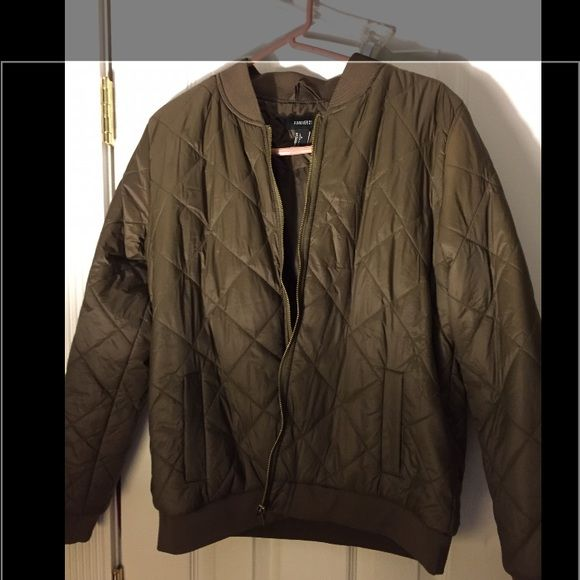 Forever 21 bomber jacket Forever 21 bomber jacket; olive green/brown biker jacket. Size large. Never worn (tried on) but tags are ripped off (thinking it would fit). Excellent condition. :) NO TRADES Forever 21 Jackets & Coats