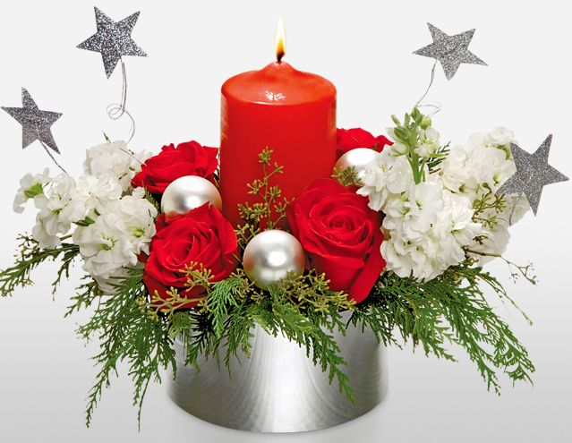 Celebration Bouquet on Sale. A traditional #centerpiece with roses and white stock is accented with silver balls and stars to create that magical look.