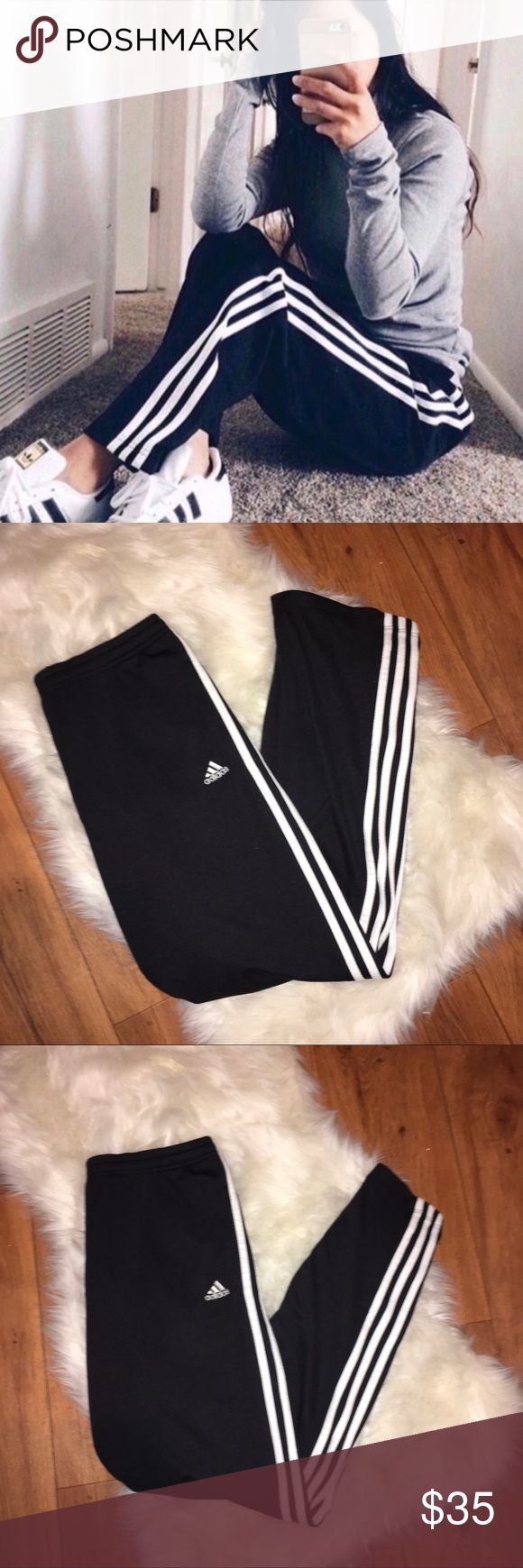 💫 Adidas Superstar Track Pants ✨Adidas Superstar Athletic Track Pants  - Black with white racing stripes down sides. Vintage 90's style.  Logo on front - Size Womans medium  - %100 polyester - light weight Jersey material, super comfortable  - loose, slouchy fit, strait legs, full length Perfect new condition - NWOT - purchased from PACSUN TAGS: #pacsun #athletic #90s #gym adidas Pants Track Pants & Joggers