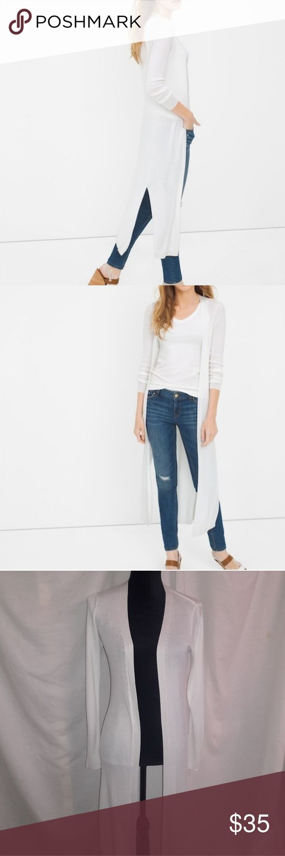 WHBM White Long Duster Cardigan S Ribbed Size Small White House Black Market brand duster, solid white in color. Open front, 1 slit on each side at the bottom. Lightweight, ribbed material. In good used condition with no major flaws, rips or stains. All items are from a pet free, smoke free home and will ship same or next day. White House Black Market Sweaters