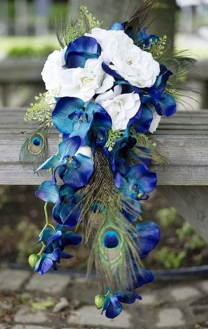 White Wedding Bouquets With Peacock Feathers : Blue phalaenopsis orchids and peacock feathers make a
