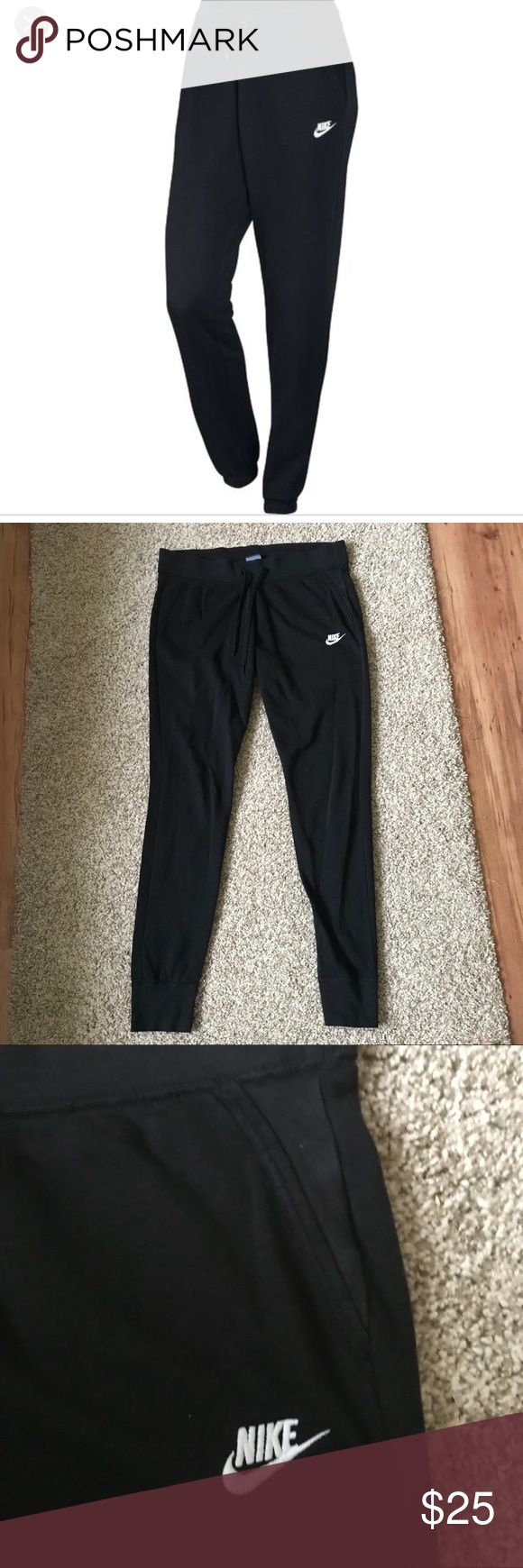‼️SALE‼️ Nike Slim Fit Joggers Sweatpants Large Women's slim cut jogger pants. Thin sweatpants material. Black with white Nike logo. Fake front pockets. These are a slim cut and run small, I'm my opinion they fit more like a medium. Minor fading from wash and wear. Still in great shape! Comes from a smoke free home. ‼️Reasonable offers are accepted! Nike Pants Track Pants & Joggers