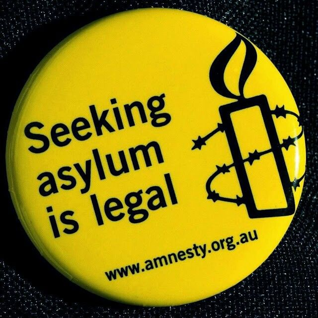 Amnesty pin : Seeking asylum is legal.