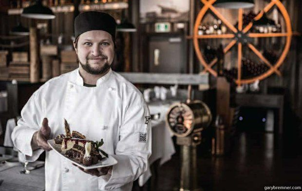 The Wheelhouse executive chef Robert Luxemburger holds the restaurant's Tastes of the Yukon dessert plate.