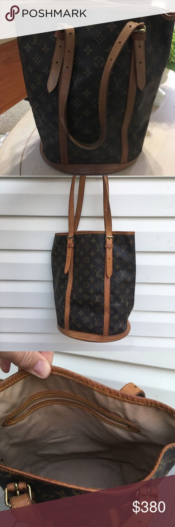 💯% Authentic lv large bucket bag Great bag . Outside normal wear. Scratches, rubbing. Inside no peeling no sticky. Louis Vuitton Bags Shoulder Bags