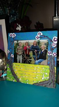 A picture frame that was silver. Hot glued some texture on it and then painted over it with acrylic paint.