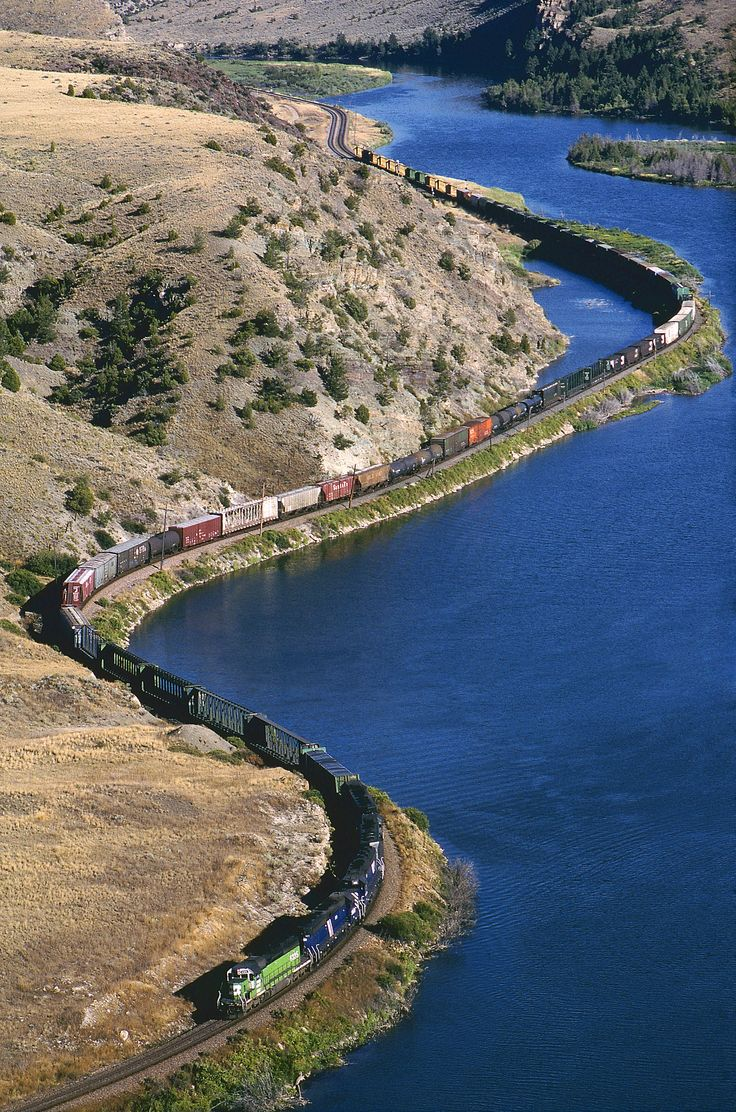 https://flic.kr/p/tpeiTu | First one at Lombard | Burlington Northern's very first SD40-2 (no. 6325, built 2/1972) leads two Montana Rail Link SD45-2s, two MRL SD45s and BN train 125 through Lombard Canyon just west of Lombard, Montana, on September 1, 1996.