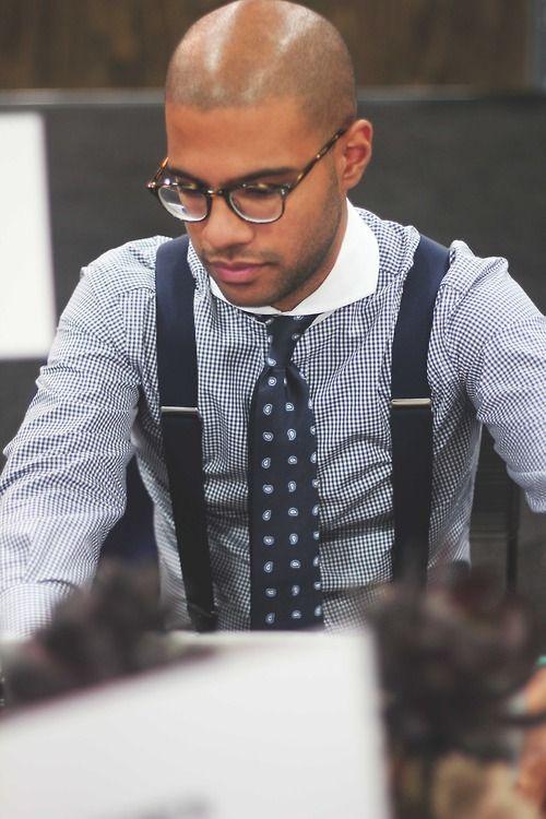 Blue. Suspenders and tie.