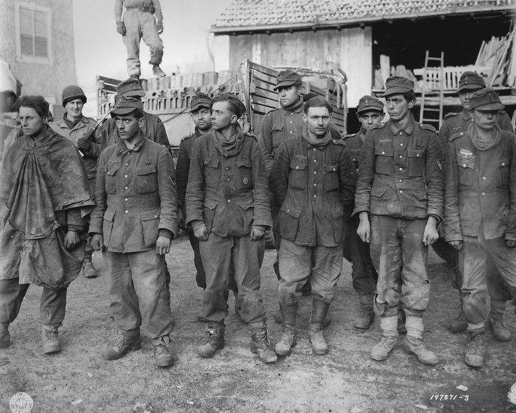 """German prisoners belonging to 352.Volksgrenadier Division, surrendered to the Allies in the town of Merzig in Luxembourg, Dec 24, 1944. The prefix """"Volks"""" indicates a formation manned by a mix of too young and too old reservists.: 1944, Ii Photos, German Prison, German Pow, 352 Volksgrenadi Division, Division Awaits, Photos Nazi, Photos Shared, Wwii Europe"""