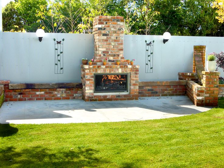 DIY fireplaces don't beat buying one that kicks out amazing heat.  This brick one looks DIY but will keep guests warm for hours.