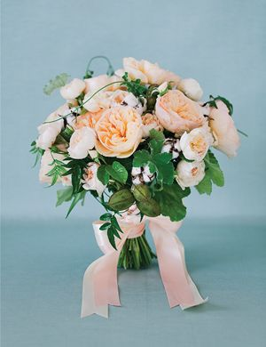 """""""Blush and Bashful"""" bouquet with garden roses, cotton, vines, peach fruit, and geranium leaves 