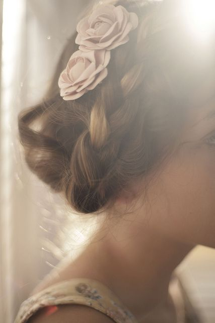 Floral pins and braids wedding updo