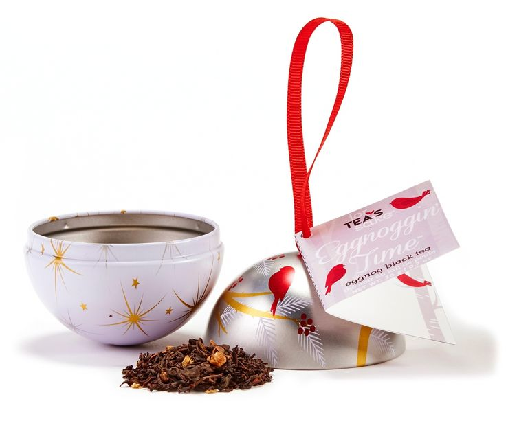 """This tin-plated ornament with ribbon hanger contains """"Eggnoggin' Time"""" black loose leaf tea. The tea features a blend of classic black tea, cinnamon, ginger pieces, clove pieces, and other natural flavourings."""