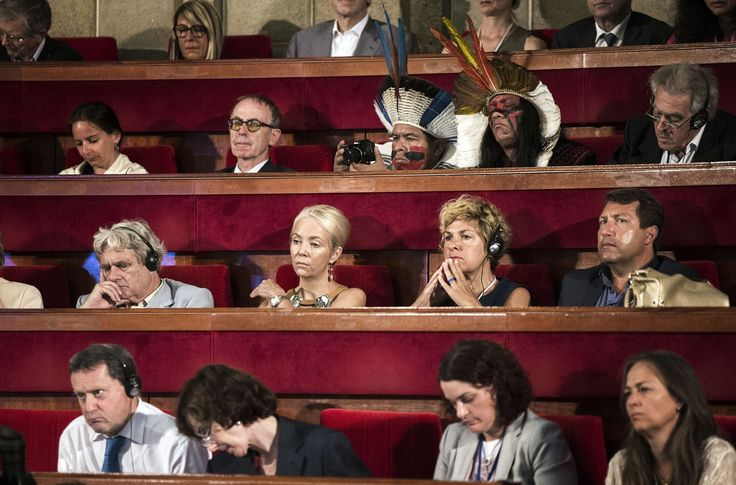 Paris, France Participants, some in traditional clothing, attend the opening of the Paris Summit of Conscience for the Climate, at which an appeal against climate change is to be launched Photograph: Etienne Laurent/AFP/Getty Images
