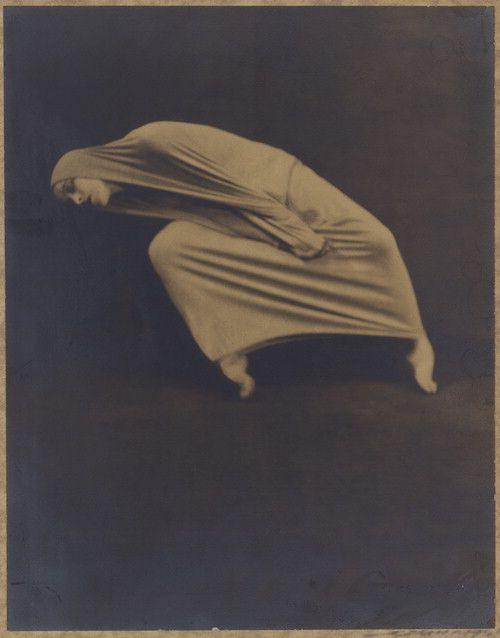 "Martha Graham during a 1935 performance of ""Lamentation"".  Photographed by Barbara Morgan."