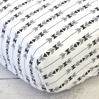 This crib sheet features a bold and modern black aztec arrow pattern on a white background.  This fitted crib sheet coordinates beautifully with Caden Lane's designer Black & Gold Aztec Baby Bedding.