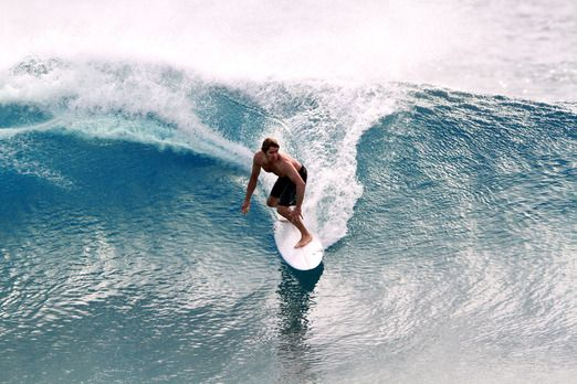 A surfer riding a wave on surfboard. Photo courtesy of Intan Tanjung via The Jakarta Post Travel.