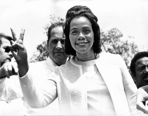 Coretta Scott King flashing the peace sign at an anti-war rally at the White House on May 9, 1970.