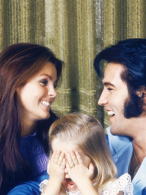 Elvis, Priscilla and Lisa Marie Presley photographed by Frank Carroll, 1970.