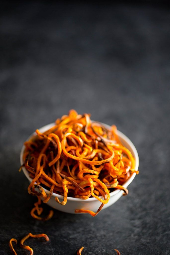 These Spiralized Sweet Potato Fries are perfectly crisp and pair so well with the Curry Aioli Sauce and green onions I paired with it! Healthy & delicious.
