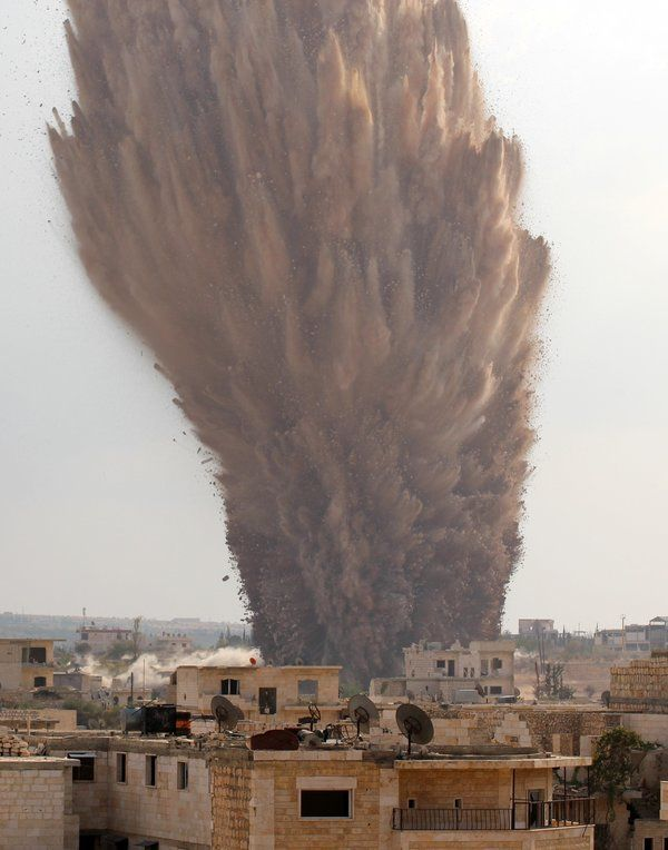 A picture taken on October 14, 2014 shows a large explosion allegedly hitting a Syrian army military outpost in the southern part of the city of Maarat al-Numan in the Idlib province. The explosion was reportedly caused by rebel fighters belonging to Ahrar al-Sham brigade of the Islamic Front coalition who dugged a tunnel underneath the outpost and loaded it with explosives.  AFP PHOTO / AL-MAARRA TODAY / GHAITH OMRAN        (Photo credit should read GHAITH OMRAN/AFP/Getty Images)