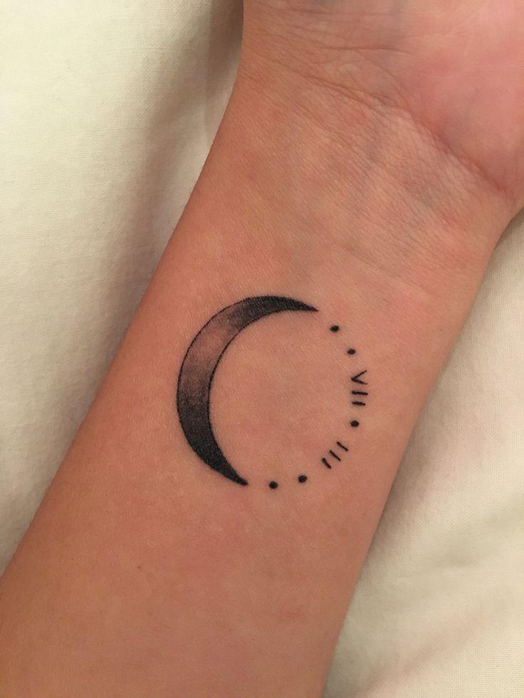 Crescent moon tattoo. Roman numerals.