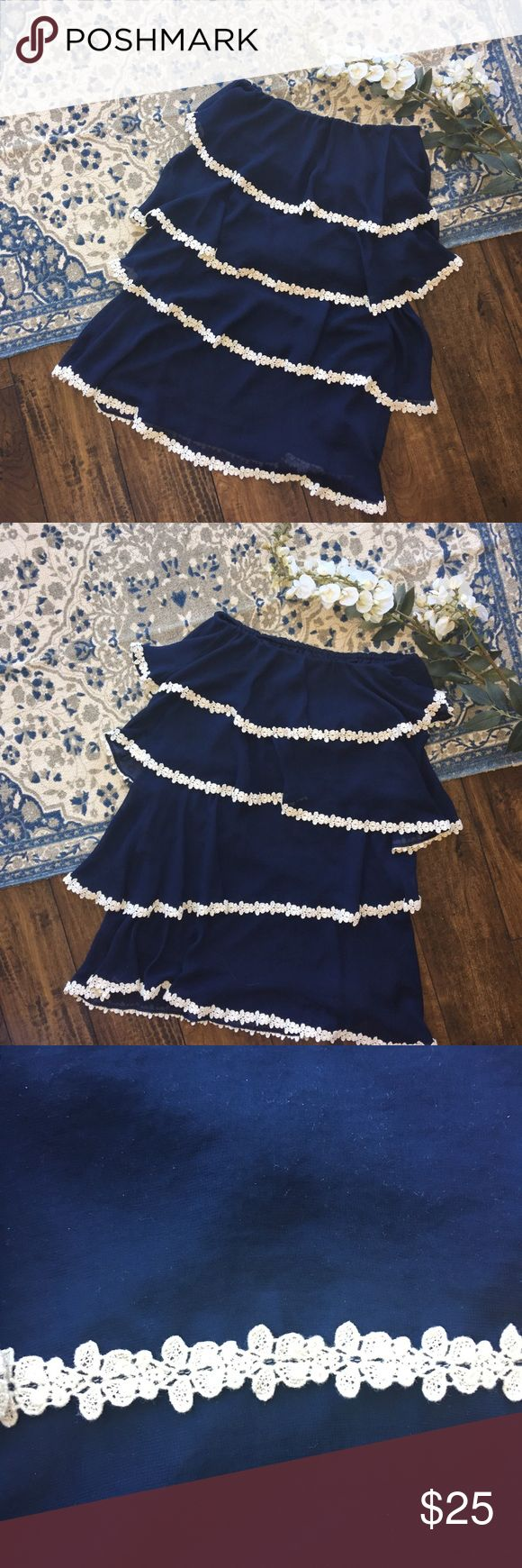 Navy Judith March Tier Strapless Dress Size Medium Navy Judith March Tier Strapless Dress. Perfect for spring! It is lined and has 4 tiers. It's worn but in excellent condition. See picture for material. Dress is 26 1/2 inches long. Judith March Dresses Strapless