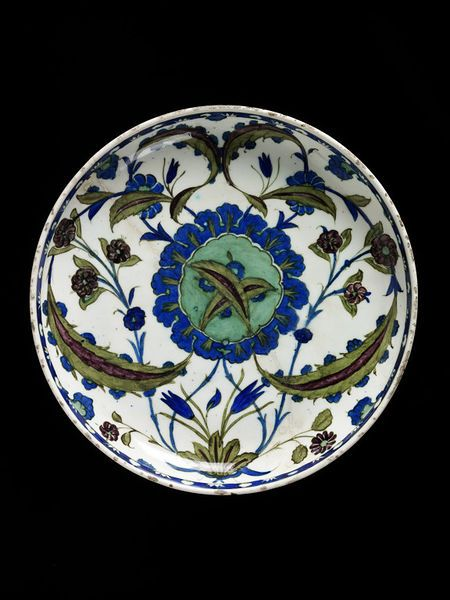 Dish | Iznik, Turkey, ca. 1545-1550 | Dish of fritware, painted with flowers and leaves in polychrome under a clear glaze | VA Museum, London