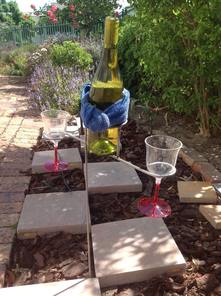 Bottle and glasses holder, stainless steel. Various heights available. Score. From R70. www.equipicnic.co.za