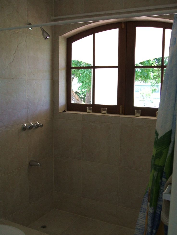 Huge shower with it's own view of the gorgeous tropical private back yard gardens!