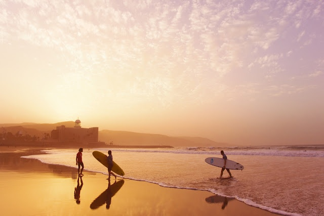 surfers at sunset on Canteras Beach in Gran Canaria