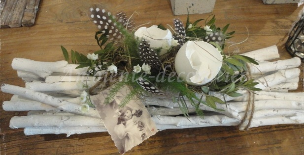 EASTER deco:  white painted sticks tied up, some twigs, moss, feathers and egg shells