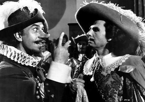 Jóse Ferrer as swordsman/poet Cyrano de Bergerac delivers a volley of putdowns-to Vicomte de Valvert (Albert Cavens) in the motion picture Cyrano De Bergerac (1950)