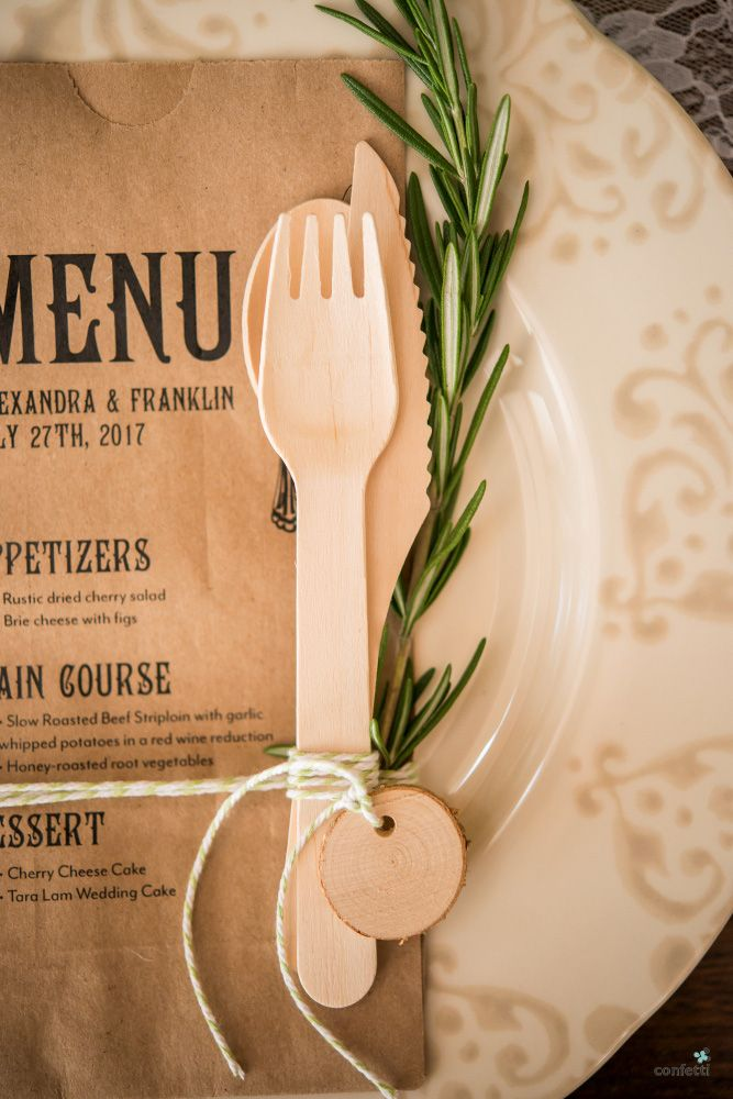 Rustic wedding theme   Rustic table decor set up ideas   Wooden cutlery set tied with string   Confetti.co.uk